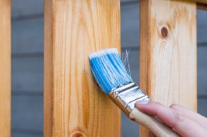 Painting the wooden fence in Hampton after house extension