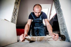 Builder is tiling the floor